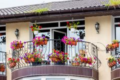Balcony of a modern building, decorated with flowers in pots. Mo. Dern style in architecture Royalty Free Stock Image