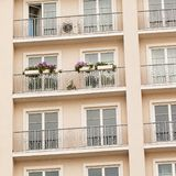 Balcony decorated with flowers. Balcony of a multi-storey apartment decorated with flowers in pots Royalty Free Stock Image
