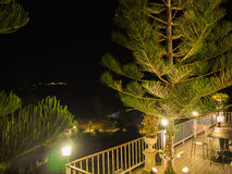 Balcony near garden in  night Royalty Free Stock Image