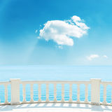 Balcony near sea and white cloud in blue sky Stock Images