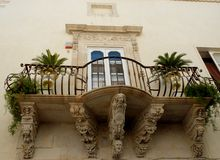Balcony with nice shelves in Syracuse in Sicily Royalty Free Stock Photography