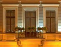 Balcony on night facade of Kempinski Hotel Moika 22. Several windows and balcony in a row on night illuminated facade of the Kempinski Hotel Moika 22 front view Royalty Free Stock Photo