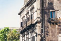 Balcony in old baroque building in Catania, traditional architecture of Sicily, Italy.  royalty free stock image