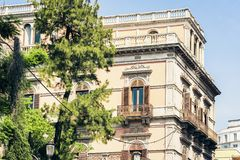 Balcony in old baroque building in Catania, traditional architecture of Sicily, Italy.  royalty free stock photos