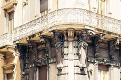 Balcony in old baroque building in Catania, traditional architecture of Sicily, Italy.  royalty free stock photography