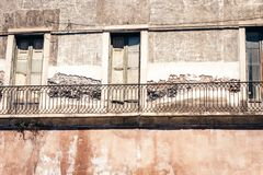 Balcony of old baroque building in Catania, traditional architecture of Sicily, Italy.  stock photo