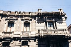 Balcony of old baroque building in Catania, traditional architecture of Sicily, Italy.  royalty free stock photography