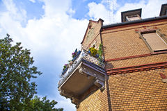 Balcony at an old brick house Royalty Free Stock Photos