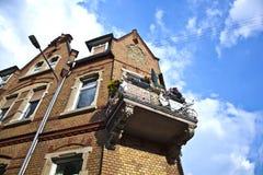 Balcony at an old brick house Royalty Free Stock Image