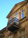 Balcony on old building. With blue windows Royalty Free Stock Photography