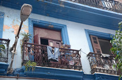 Balcony in old Havana with blue jeans. Royalty Free Stock Photo