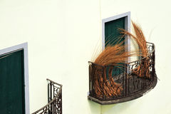 Balcony at old house in Madeira with package of wi. Cker Royalty Free Stock Photography