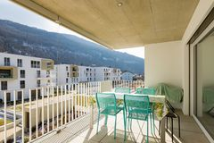 Balcony with outdoor furniture, sunny day. Balcony with outdoor furniture. Residence overlooking the hills in the sunny day royalty free stock photography