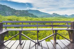 Balcony overlooking the bench, forests, and mountains royalty free stock photo