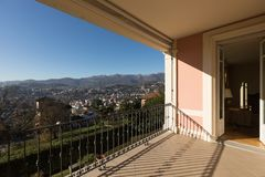 Terrace of vintage villa. Nobody inside. Balcony of a period villa with a fantastic view of the city of Lugano with the mountains behind. Wonderful day Stock Image