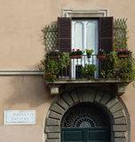 Balcony, Piazza Navona, Rome. Window and ornamental balcony with flowers above doorway, Piazza Navona Stock Images