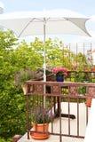 Balcony plants pots parasol table Royalty Free Stock Photos