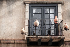 Balcony with pottery decorations Royalty Free Stock Photography