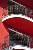 Balcony railing of iron. Modern building with red plaster stock images