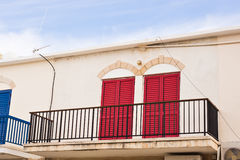 Balcony with red doors royalty free stock images