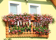 Balcony with red and pink flowers Stock Photography
