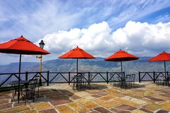 Balcony with red Umbrellas in Panachi, Santander, Colombia royalty free stock photography
