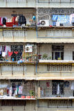 Balcony of residence in South of China. Balcony with grid of people residence in South of China, shown as various living environment in different place of the Royalty Free Stock Photo