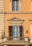 Balcony in Rome. With typical pastel colored stucco Stock Images