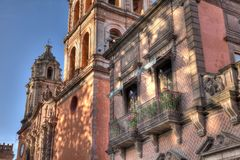 Balcony of San Luis Potosi, Mexico. Old balcony that is slightly restored in San Luis Potosi, Mexico with San Francisco church in the background stock images