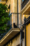 Balcony of sandstone building with black cat on it, Tarragona Spain Royalty Free Stock Image