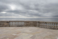 Balcony with sea side with and old marble balustrade. And cloudy sky Royalty Free Stock Image