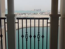 Balcony with a sea view. On the Pearl island in Doha, Qatar royalty free stock photo