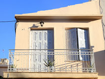 Balcony with shutter windows in an old house, Greece. Balcony with shutter windows in an old house in Rethymno, Crete, Greece Stock Photography