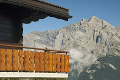 Balcony of a Swiss chalet. Against the peaks of the Swiss Alps, Nendaz, Valais, Switzerland Royalty Free Stock Photo