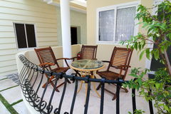Balcony with Table and Chairs. Image of balcony with table and chairs Stock Image