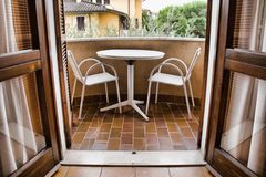 Balcony with table and chairs royalty free stock image