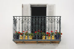 Balcony from Tarifa. An iron balcony with red flowers in Tarifa, south of Spain royalty free stock photos