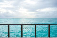 Balcony to crystal clear ocean from water villa private balcony, Maldive. S stock photos