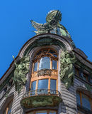 The balcony of the upper floor of the house-singer-. The balcony is richly decorated with sculptures and relief. Decorations. The glass dome above the balcony Stock Images