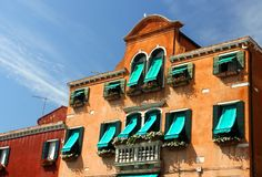 Balcony in Venetian style with Windows and green awnings. Balcony in Venetian style with arched Windows and green awnings Stock Photography