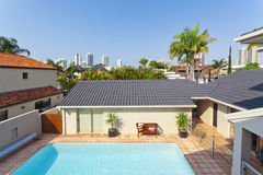 Balcony view looking at pool area and skyline Royalty Free Stock Image