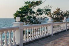 Balcony view on the sea. Shore on a sunny day. Summer Royalty Free Stock Photo