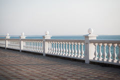 Balcony view on the sea. Shore on a sunny day. Summer Royalty Free Stock Image
