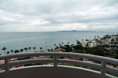 Balcony view to the ocean and neighborhood houses near Jomtien beach area in Thailand Stock Photography