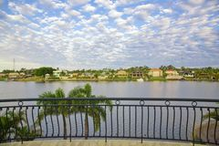 Balcony views from waterfront Mansion. Overlooking the canal Royalty Free Stock Image