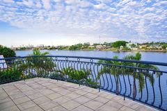 Balcony views from waterfront Mansion. Overlooking the canal Royalty Free Stock Photo