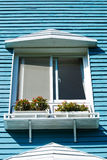Balcony of villa with blue wooden wall Stock Photo
