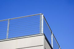 Balcony with white parapet of the blue sky.  Stock Photography