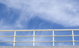 Balcony with white parapet of the cloudy sky Royalty Free Stock Photography