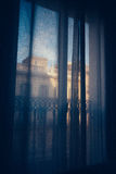 Balcony window with curtains Stock Photography